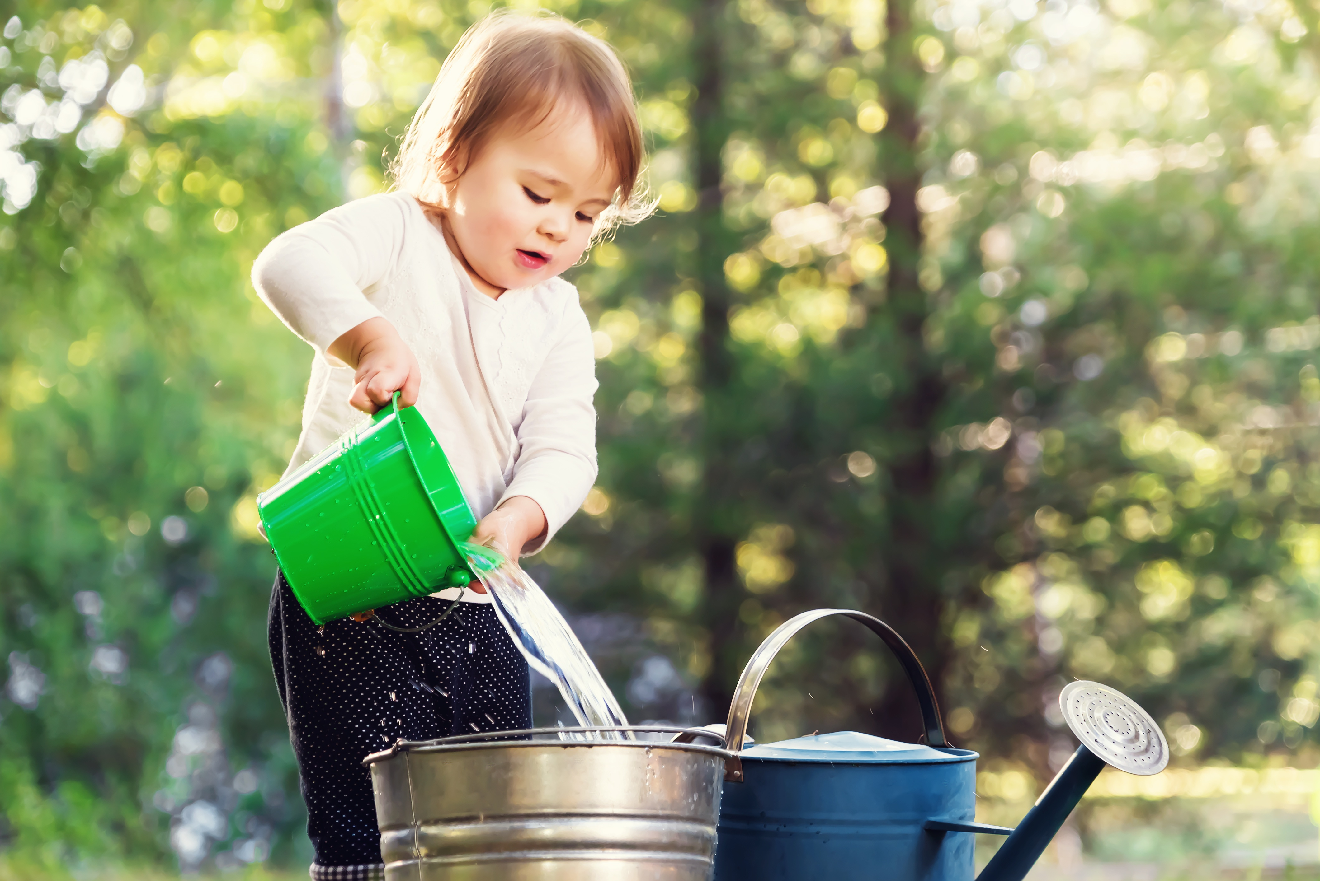 image shows a child playing outside - the benefits of outdoor play